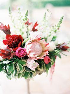 Gorgeous protea arrangement: http://www.stylemepretty.com/2015/09/16/modern-austin-garden-party-wedding/ | Photography: Jen Dillender - http://jendillenderphotography.com/wp1/
