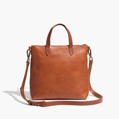 "The Transport Crossbody bag from Madewell in black or ""English saddle"" brown"