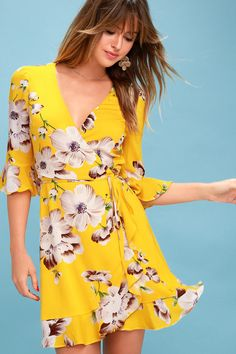 The Swinging in the Rain Golden Yellow Floral Print Wrap Dress is just like a dose of sunshine on a rainy day! Surplice neckline and wrap skirt.