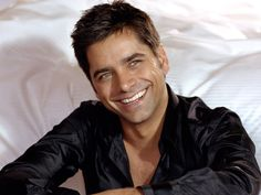 John Stamos.  I think he has a portrait in the attic.