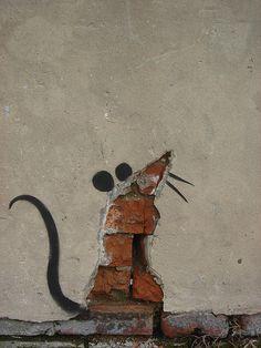 Street art. rat . Part of a larger piece.