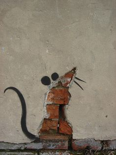 Street art. rat . Part of a larger piece.