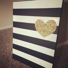 Wall art repurpose with spray paint DIY Tutorial. Spray paint does wonder! I started with a picture that I no longer wanted. Using Frog Tape, I made stripes then added spray paint. Final touch was the gold sparkle heart.