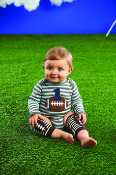 5b493cc98de Striped cotton long sleeve crawler features number and football appliqué.