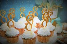 Cupcakes at a gold and blue birthday party! See more party ideas at CatchMyParty.com!