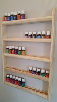 Essential Oil Wall Rack/Hanging Shelf - UNIQUE Double Holes for both size bottles by OrganizeYourOils on Etsy Hanging Shelf Rack (Oils Not Included) - Excellent Space Saver for Young Living or doTerra Bottles. . www.OrganizeYourOils.com #essentialoildisplay #essentialoilstorage #essentialoilshelf #aromatherapyrack #aromatherapyoils #aromatherapyessentialoils #oilyandorganized