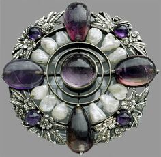 BERNARD INSTONE 1891-1987 Arts & Crafts Brooch  Silver Amethyst Pearl Diameter: 5.50 cm (2.17 in)  British, c.1915.