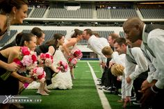 Many don't realize that if you contact your local pro or college stadium that arrangements can be made to get onto the field for wedding pics
