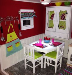 Love the finished kitchen. ❤️ thrift store $5 find became a hutch for storage with fresh paint & scrap boarding paper. Table & chairs retired AG. Reversible rugs & even window treatments. So cute!!!