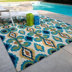 The Portia rug takes high-fashion Ikat patterns outdoors. The allover designs enjoy a rich, bold and bright palette. The hand-hooked rug features three dimensions of texture for an overall look that exceeds expectations for an indoor/outdoor product.