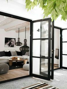 Black French Doors Patio triple french doors off the kitchen open up to let the outdoors in
