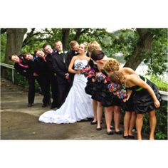 Adorable wedding pose with both groomsmen and bridemaids