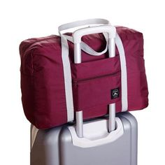 Travel in style and comfort with this large carry-on tote bag. Big enough to hold plenty of stuff, yet small enough to be your personal item on the airplane. www.wowgreatgifts.com