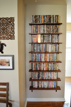 DVD storage can be difficult for small apartments and houses. Check out these 10 clever and easy DVD storage ideas for small spaces for a creativity push. Dvd Storage Cabinet, Dvd Storage Boxes, Dvd Storage Shelves, Storage Ideas, Movie Storage, Storage Solutions, Game Storage, Dvd Wall Shelf, Movie Shelf