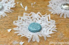 Add a flurry of white to your home with these beautifully delicate bottle top snowflake christmas decorations. Simple, thrifty Christmas style.