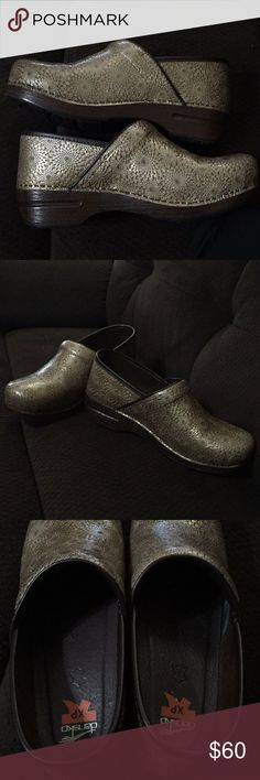 Dansko XP gold medallion real leather clogs These are in excellent condition!! Size 41 which is about a women's 10.5/11. Beautiful and classy gold medallion design that looks good with everything. Extremely comfortable for anyone on their feet Dansko Shoes Mules & Clogs