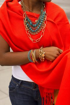 Orange crush! well, you already have your blue jeans or skinnys... and a white strech cotton top... so style this outfit w. a hot orange pashmina... fill your neck and wrist with color stones and chains... a messy updo will do the rest...