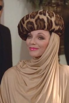 "Know how to work a hat -— no matter how ridiculous it looks. | 19 Impeccable Style Tips From ""Dynasty's"" Alexis Carrington"