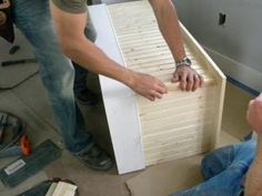 Measure two vertical corner trim pieces and cut to cover the front corners where the bead-board panels meet. Set pieces on top of the baseboard and snug them up under the overhang.