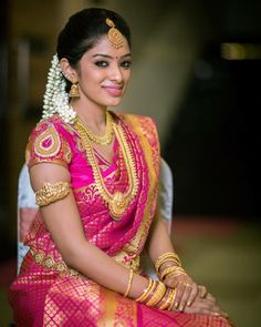 South Indian bride. Gold Indian bridal jewelry.Temple jewelry. Jhumkis.Pink silk kanchipuram sari.Braid with fresh jasmine flowers. Tamil bride. Telugu bride. Kannada bride. Hindu bride. Malayalee bride.Kerala bride.South Indian wedding.