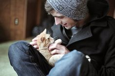 He's in a beanie, a peacoat, and he's playing with a cat... ahh<3