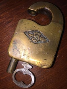 This is a very nice medium brass Slaymaker padlock. It is in great condition with a delicious smooth brass patina. No key. Knobs And Knockers, Knobs And Handles, Antique Keys, Vintage Keys, Skeleton Key Lock, Door Knob Lock, Antique Shelves, Old Car Parts, Cool Lock