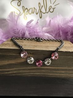 A personal favorite from my Etsy shop https://www.etsy.com/listing/511747223/12mm-swarovski-crystal-5-stone-necklace