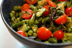asparagus basil salad;  1 lb asparagus, trimmed and halved  1 cup grape tomatoes, halved  1 ripe avocado, cut into cubes  1 cup sliced basil leaves  ¼ cup olive oil  2 teaspoons lemon juice  2 teaspoons dijon mustard  ½ teaspoon celtic sea salt  ½ teaspoon pepper