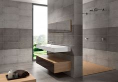 """Great modern bathroom. Fully tiled walls and floor in greys make the wood accents really """"pop""""."""