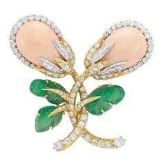 Gold, Platinum, Coral, Diamond and Carved Emerald Brooch, David Webb  Composed of two intertwined stylized flowers topped by 2 pear-shaped angel skin coral cabochons approximately 22.0 x 15.0 mm., surrounded by round diamonds and diamond-set leaves, supported by diamond-set stems tipped by 2 pear-shaped diamonds, flanked by 3 carved emerald leaves, totaling 95 round and 2 pear-shaped diamonds approximately 5.00 cts., signed Webb, approximately 21.3 dwts.
