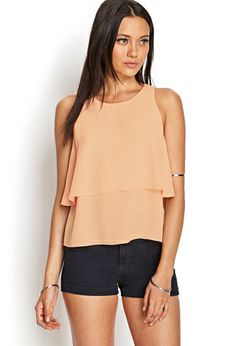 Breezy and lightweight, this woven tank features a flounced top and a round neckline.