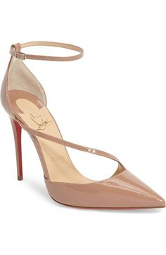 8cb938b26fa3 fliketta pump by Christian Louboutin. A slender band arcs across the vamp  of a sultry pointy-toe sandal fitted with a slim ankle strap-while a  lacquered red ...