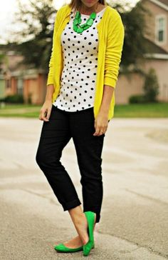 Black jeans, polkadot shirt, yellow sweater, lime accessories