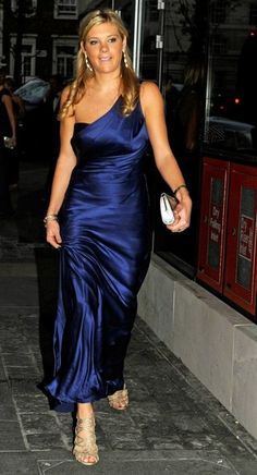Chelsy Davy Evening Dress - Chelsy Davy shined at the Boodles Boxing Ball in a one shoulder midnight blue crepe satin gown. She finished the look with metallic strappy sandals.