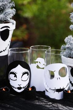 """""""Boys and girls of every age, wouldn't you like to see something strange?"""" Create these DIY creepy candle holders featuring Jack Skellington and Sally from Tim Burton's The Nightmare Before Christmas. Just use the free printable at Disney Family and cut out these nightmarish designs and attach to jars or candle holders to add some light to your Halloween party."""