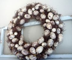 The perfect wreath idea for the Easter Dinner table! Make a couple of small versions to use with the glass hurricanes/candles