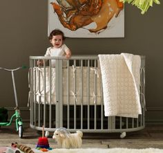 this makes my ovaries ache. love the organic circles crib sheet set. love the crib. love the little mountain goat. love the baby. and probably would love the art on the wall if i could see it all.