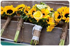 I like the twine wrapped around the bridesmaid bouquets.