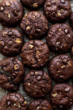 Super fudgy, thick, chewy, and rich brownie cookies with big chunks of chocolate and walnuts! Recipe on sallysbakingaddiction.com