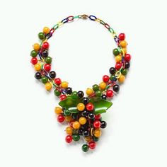 bakelite vintage neckpiece --  rub the pieces to get a whiff of that formaldehyde smell (formaldehyde is one of the ingredients in Bakelite), which is often associated with real Bakelite and is an easy test to conduct when not sure if you are looking at the real thing
