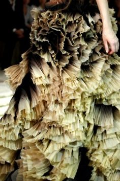 pleats layered on a skirt with different tones of colour