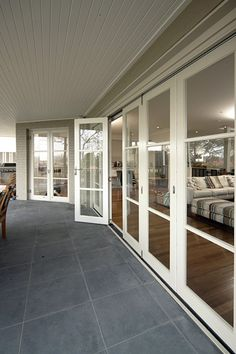 Bi-fold doors. I like this idea much better than sliding glass doors. They get junked out WAY to easy.