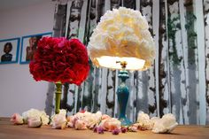 Find a cheap lamp and lamp shade at a thrift store and turn it into a lovely statement piece.