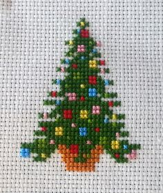 Christmas tree miniature cross-stitch by KatheStitches on Etsy https://www.etsy.com/listing/212324156/christmas-tree-miniature-cross-stitch