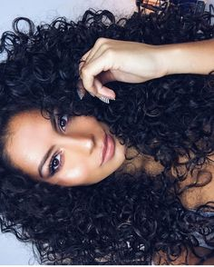 She is beautiful and the curly hair gorgeous