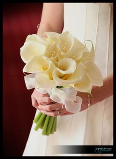 Beautiful Bridal Bouquet of Cala Lillies with  pearl detail.