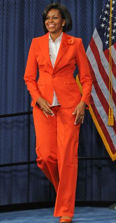 Michelle Obama Wore a Bright-Orange Hillary-ish Suit! Michelle Obama Fashion, Michelle And Barack Obama, Obama Suit, Hillary Clinton Pantsuit, Orange Suit, American First Ladies, Black Presidents, Business Attire, Lady In Red