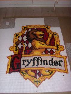 the Gryffindor emblem, from harry potter. made in hama / nabbi beads ( perler) Perler Bead Designs, Hama Beads Design, Pearler Bead Patterns, Perler Bead Art, Perler Patterns, Pixel Art, Harry Potter Perler Beads, 8bit Art, Pokemon