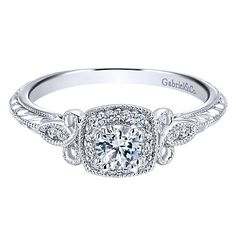 14K White Gold .37cttw Vintage Halo Diamond Engagement Ring. This ready to wear diamond engagement ring, features .37cttw of round diamonds with an engraved white gold shank with diamond accents and a