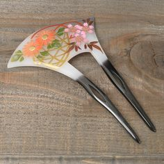 Chirikan a geisha hair accessory. (Maikos often wore seasonal flowers)